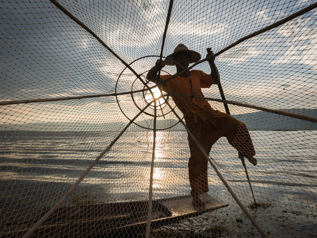 Looking through the net of a fisherman on Inle Lake