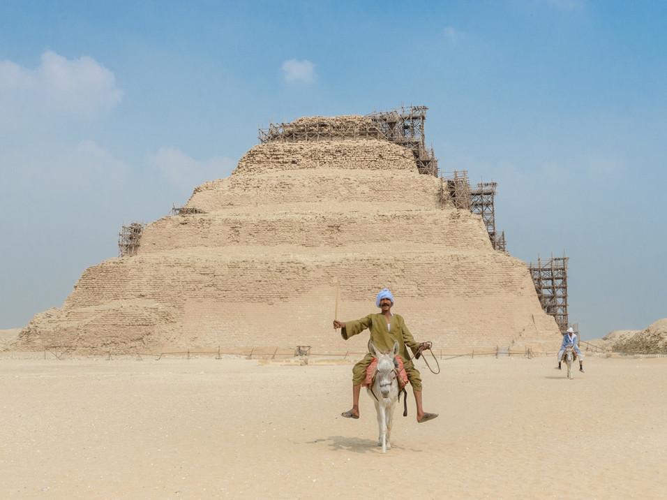 Egyptian man riding a donkey