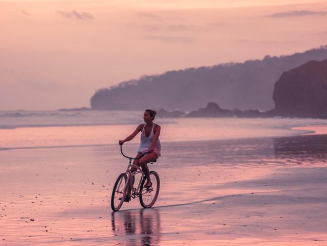 Cycling along Playa Grande, Costa Rica.j