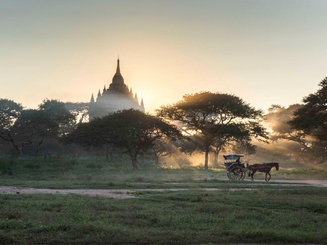 The last rays of sun break from behind a pagoda in Bagan, Myanmar