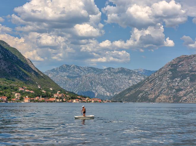 An old man paddles in Montenegro