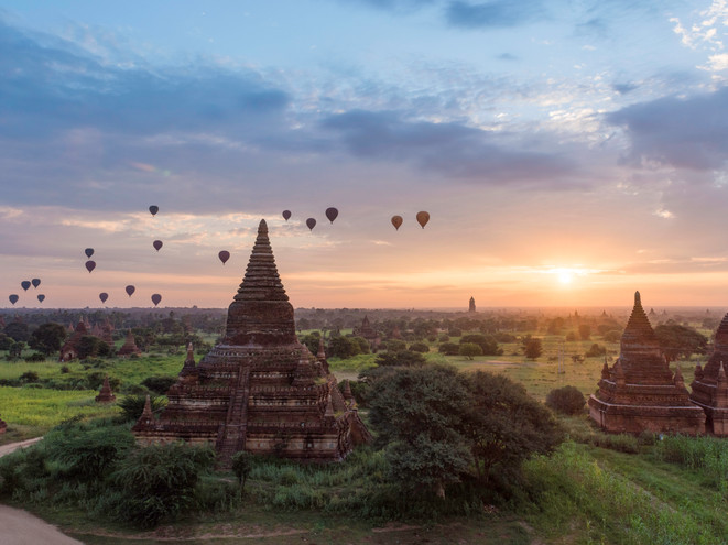 Balloons floating past pagodas in Bagan, Myanmar