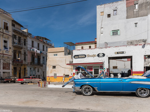 A mechanic fixes an old Cadillac in Havana