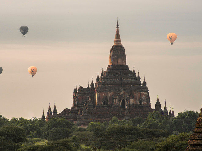 Hot air balloons floating past Sulamani pagoda, Bagan