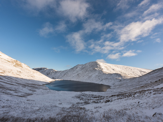 A frozen tarn in Winter in the Lake District