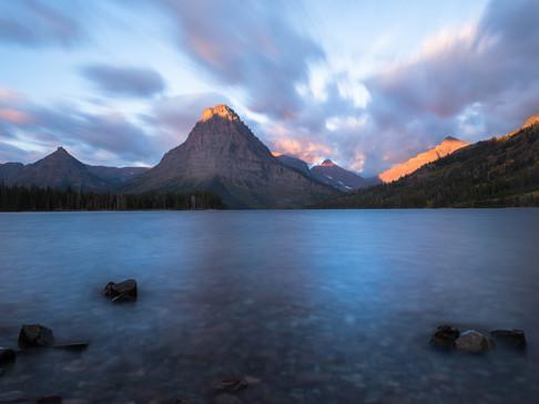 Warm sunrise over Two Medicine Lake, Gla
