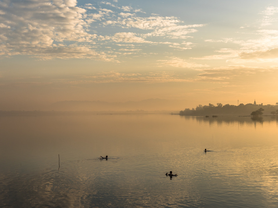 Boys fishing at dawn in Mandalay, Myanmar