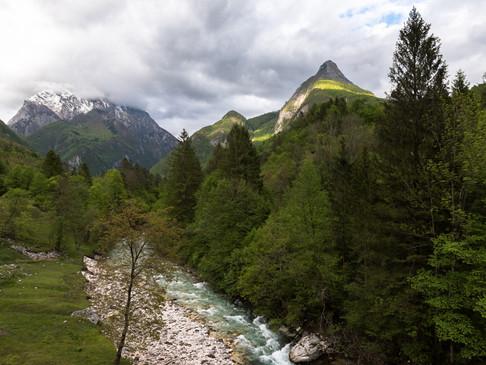 Sunlight catches top of a Slovenian mountain