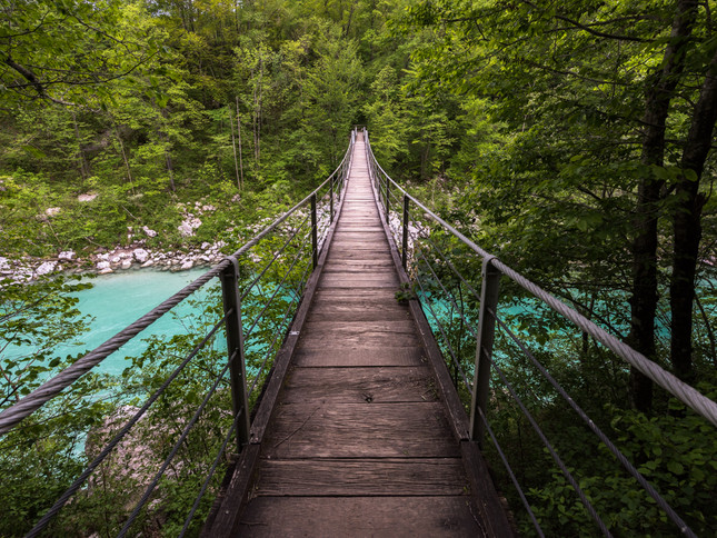 Crossing the river on a wooden walkway