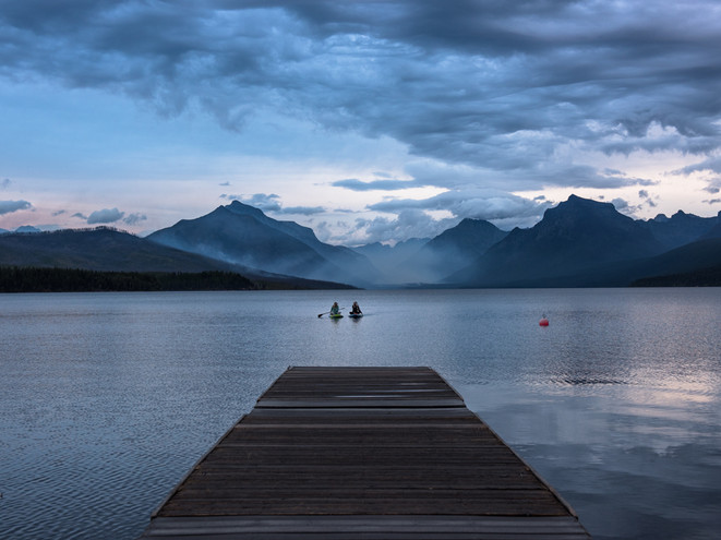 Evening kayakers on Glacier Lake