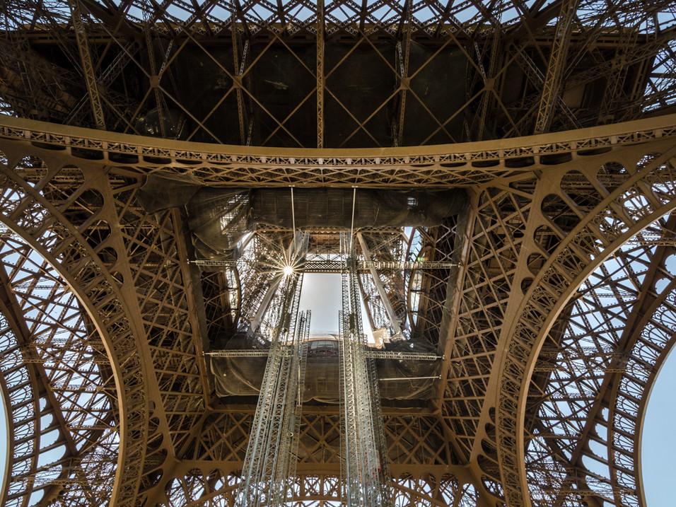 Sunburst through the Eiffel Tower, Paris