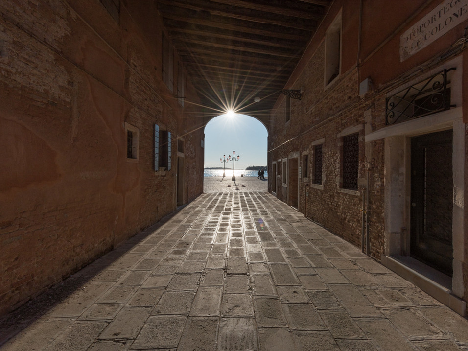 Sunburst through a tunnel in Venice