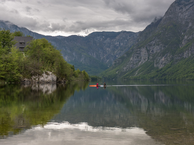 Kayakers on a lake in Slovenia