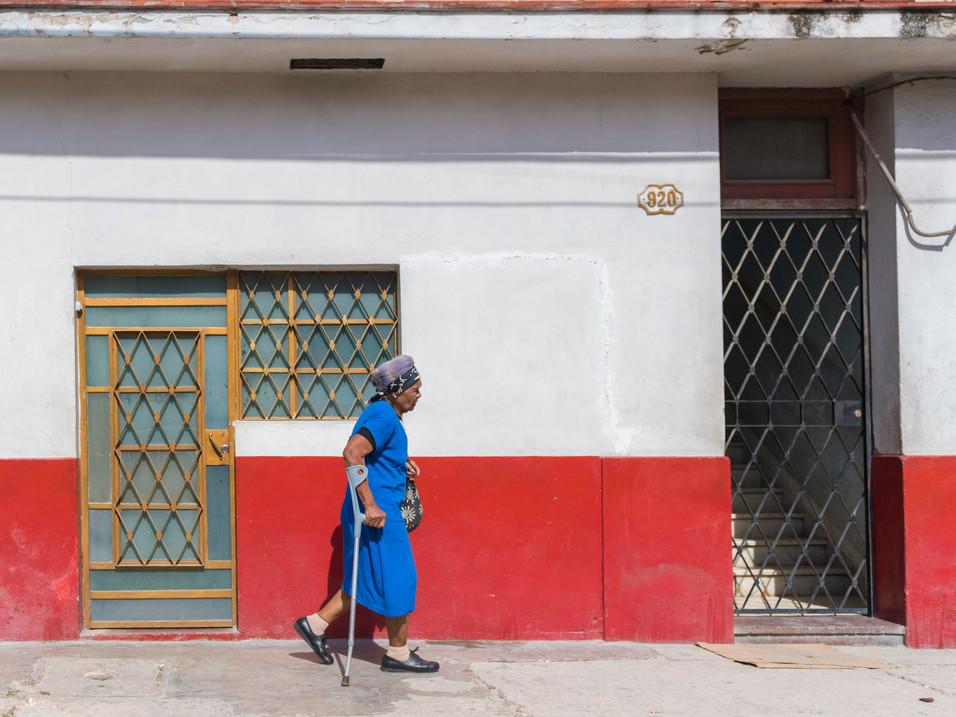 An old lady walks through Havana