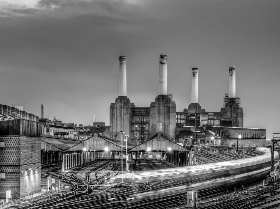 Trains pass Battersea Power Station