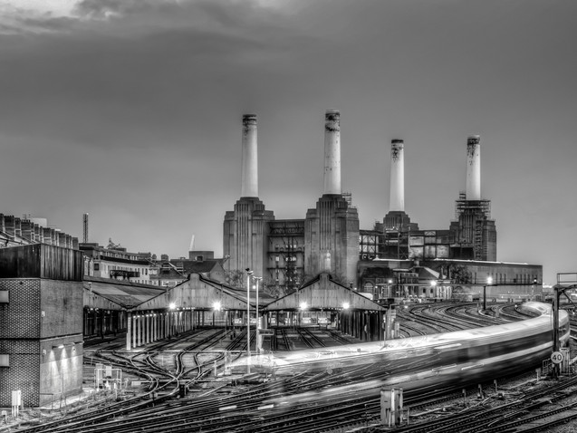 Trains pass Battersea Power Station