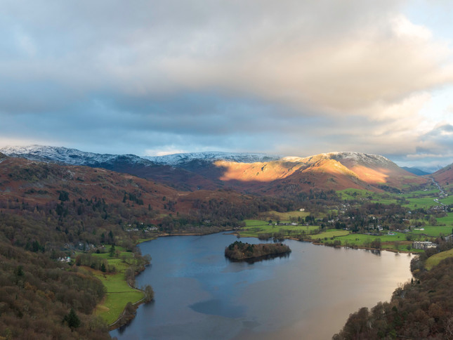 Early morning sun lights up the Lake District
