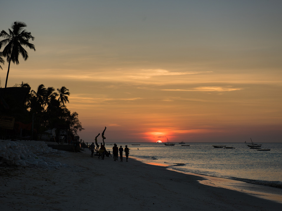 Boys doing handstands on the beach, Tanzania