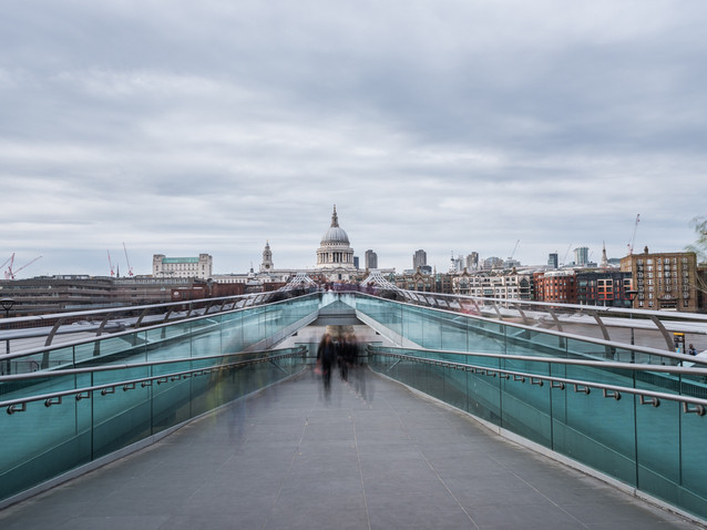 People cross the Millennium Bridge, London