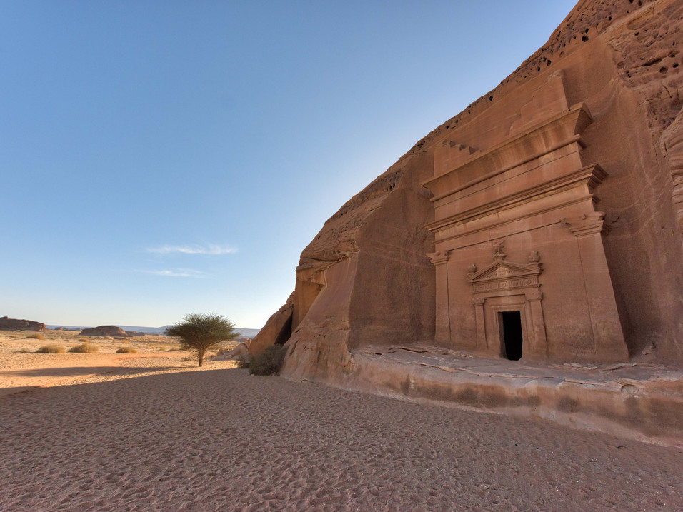 Large tombs carved into the rock in Hegra