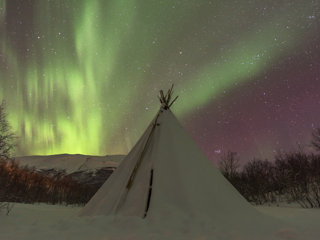 Aurora over a Swedish teepee.