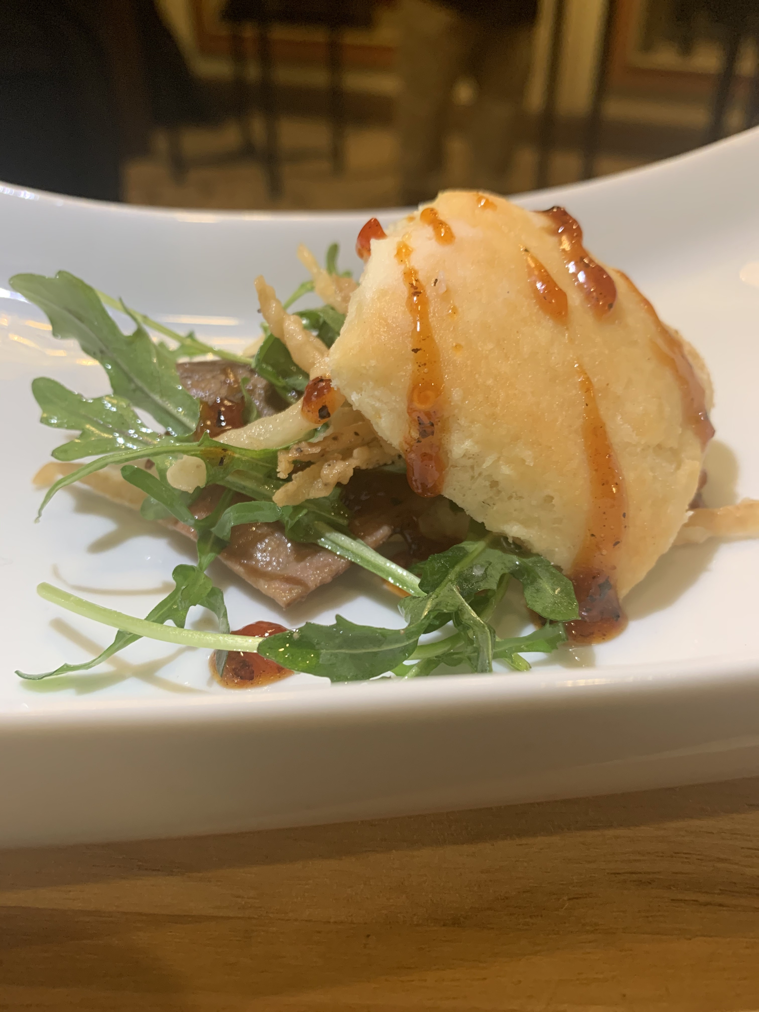 Brisket Biscuit served with Arugula Sala