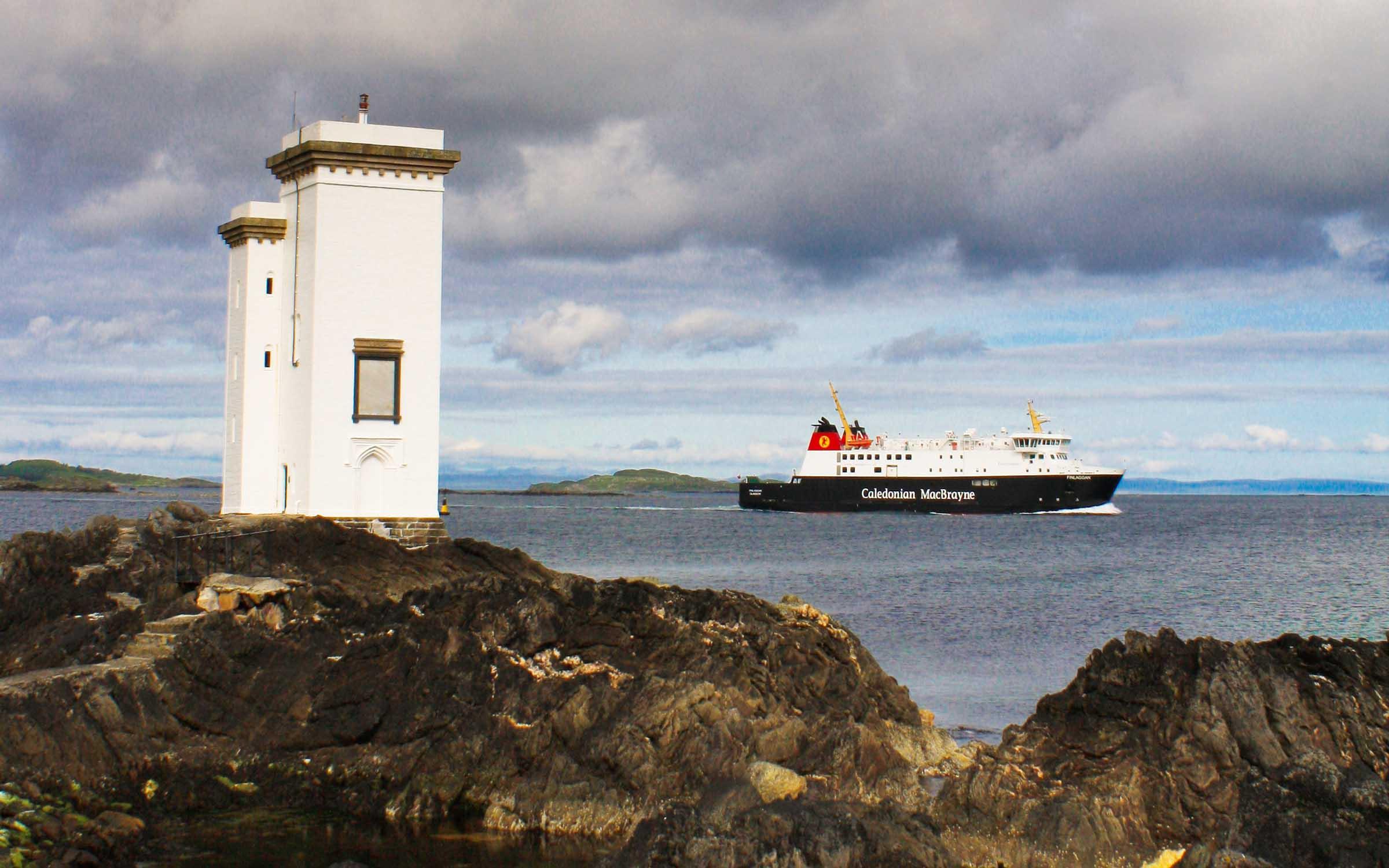 Finlaggan passing Port Ellen lighthouse (Ships of CalMac)