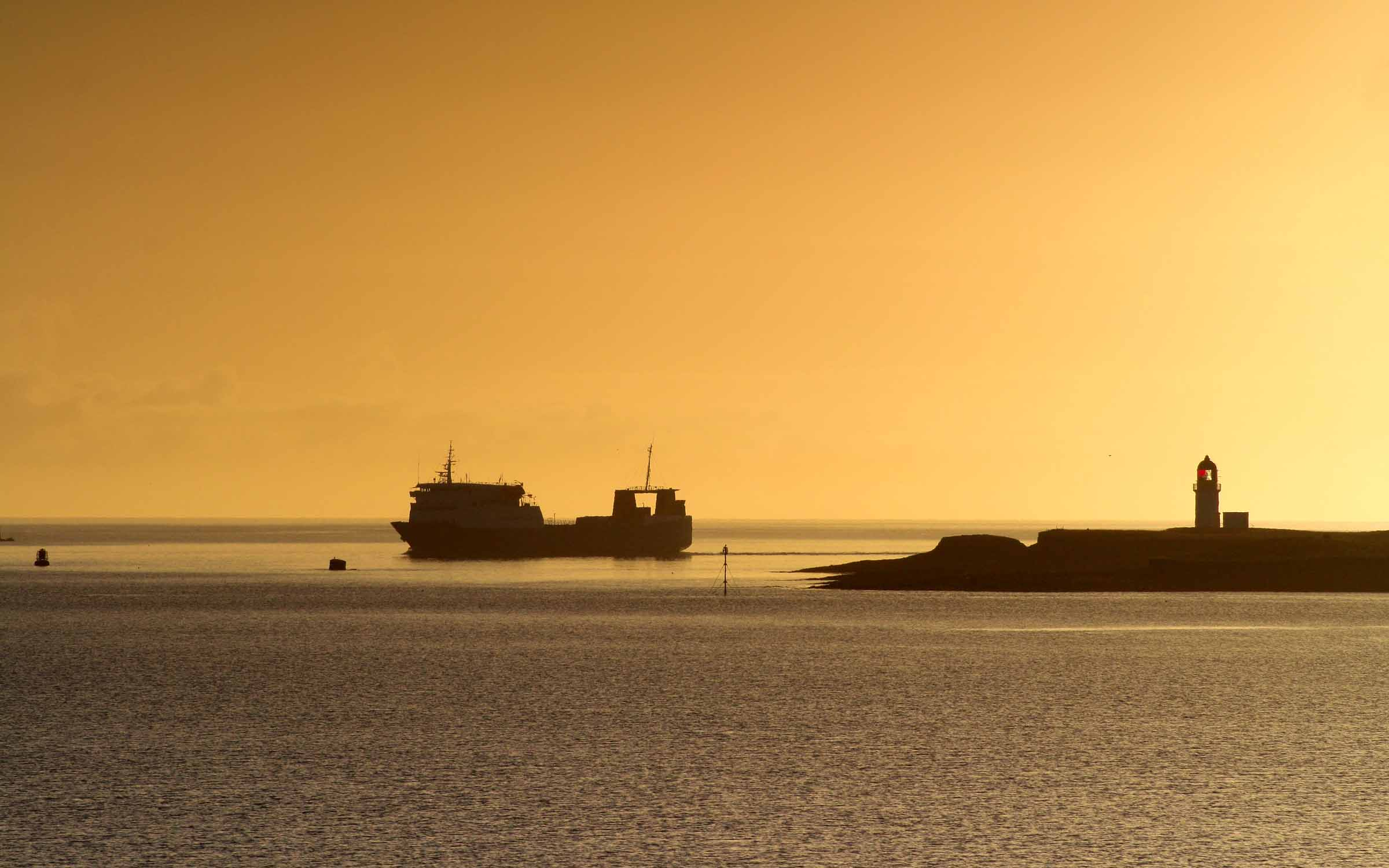 Muirneag passing Arnish Point at dawn (Ships of CalMac)