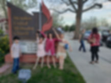 Image of children in front of the church.