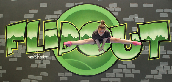 photo jumping in front of flipout sign.p