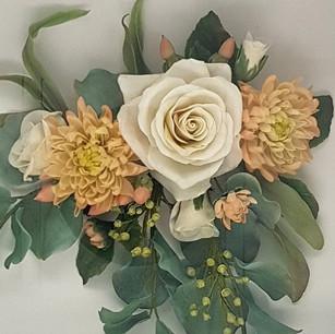 Ivory roses, peach chrysanthemums, eucalyptus and hypericum berries