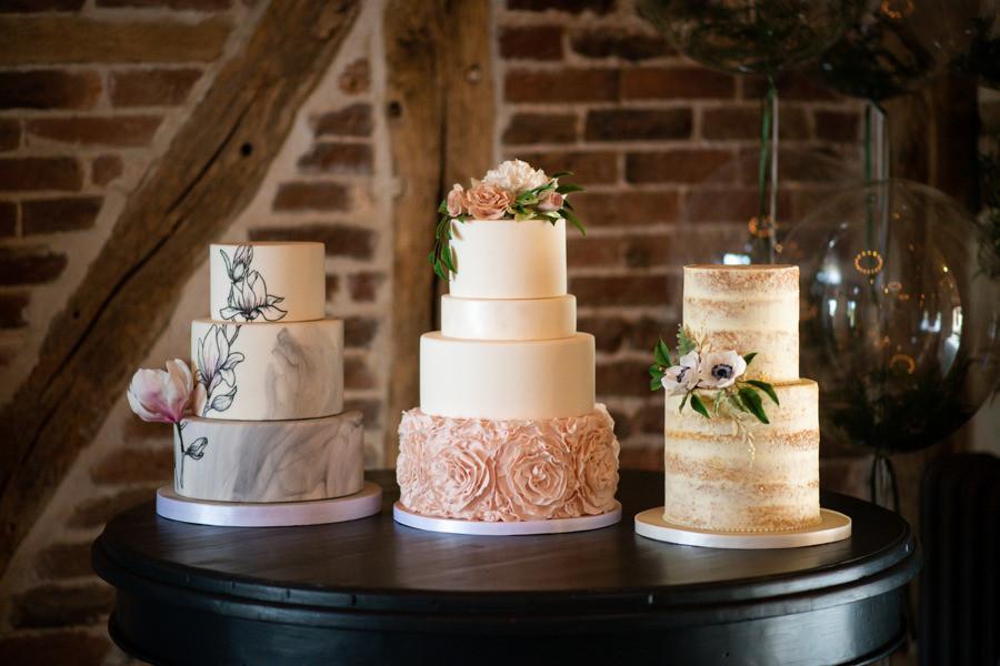 Three luxury wedding cake designs with hand made sugar flowers