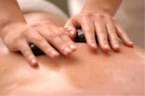 massage hands using hot stones to soothe