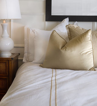 Hotel bed white and gold
