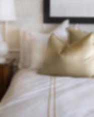 Hotel bed wit en goud