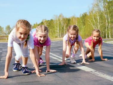 bigstock-Girls-Starting-To-Run-On-Track-