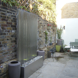 Stainless steel water wall and reservoir.