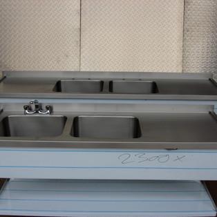 Stainless steel sinks with raised drip edge