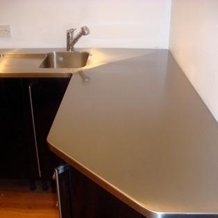 Angled corner sink unit