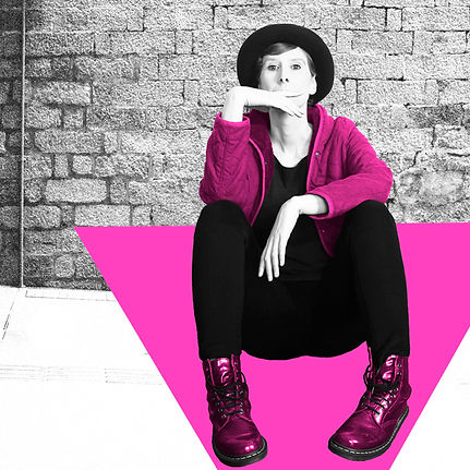 Telia Nevile sitting on the ground with her hand up to her face. The image is black and white with aspects of pink.