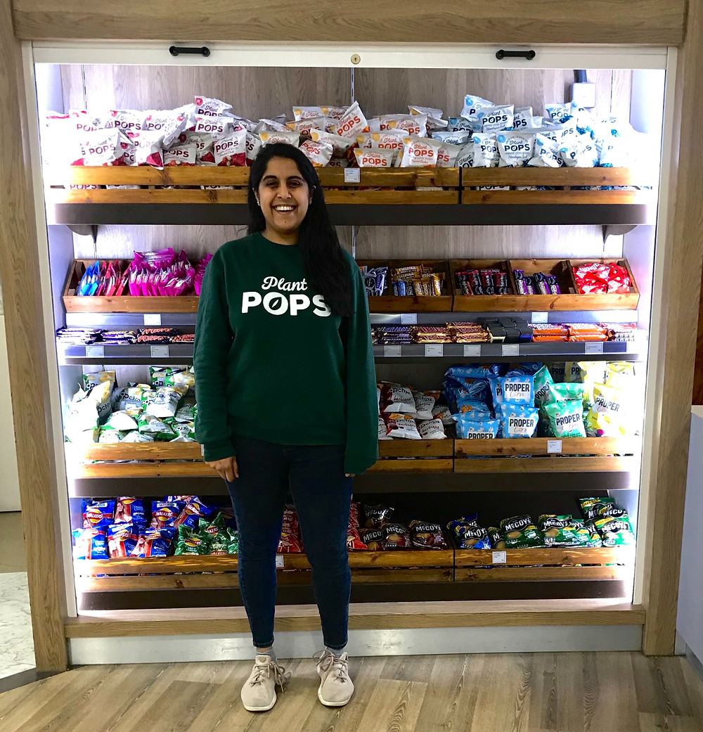 Anushi Desai stands with Plant Pops products in store
