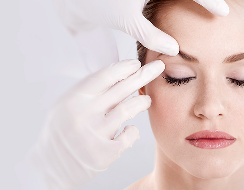 Doctor examining female patient's face