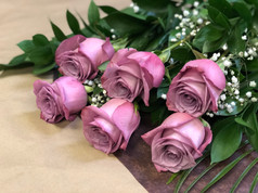 6 roses lilas 46$
