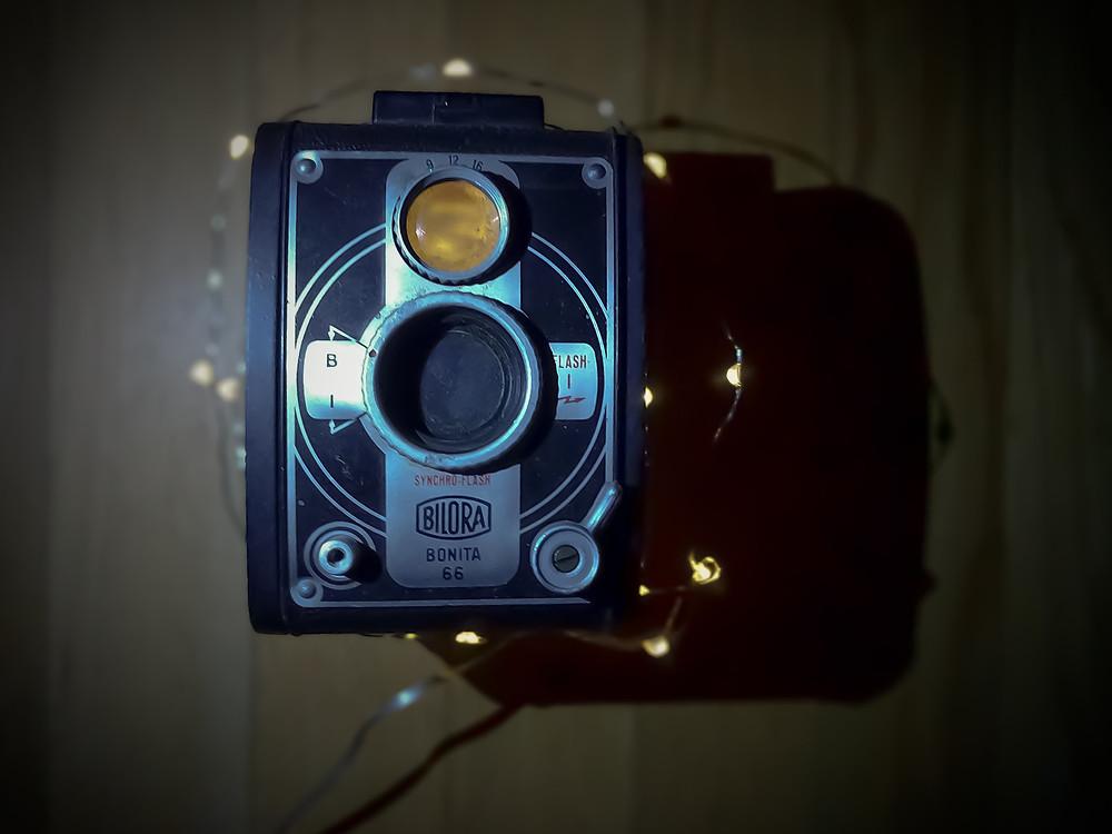 Vintage camera with lights around it