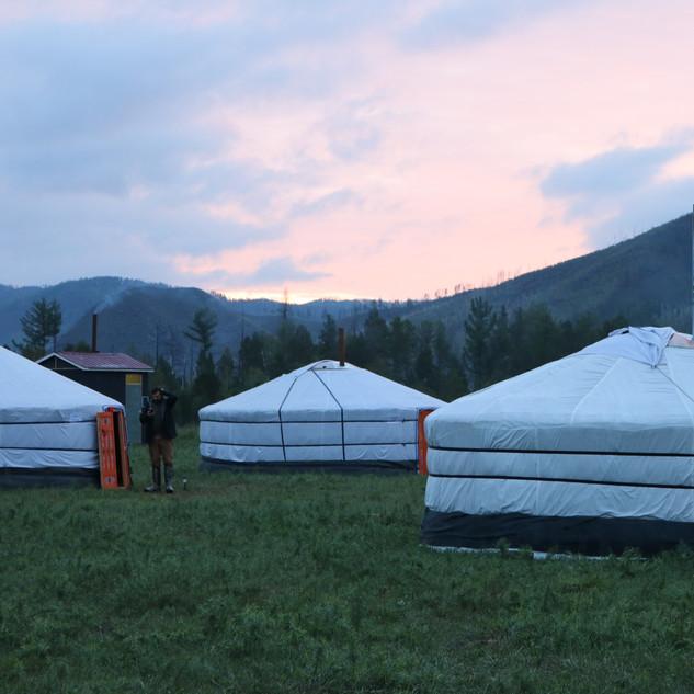 Mongolia sunrise overlooking gers