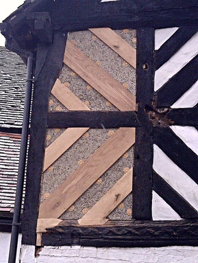 Repair works to timber framed panels.  Rotten timbers were replaced, the panels rendered with a lime-based mix and the new wood treated to match the existing.