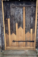 The damaged boards on this historic door were carefully replaced so that it could be used for many more years to come.  The new oak repairs were left untreated to clearly show the extent of new works undertaken.