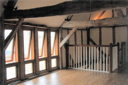 Upstairs in the office.  The original beams have been kept in place and a new stairs and bespoke windows fitted to change the use of the barn.