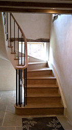 The existing stairs were replaced with an attractive wooden staircase.