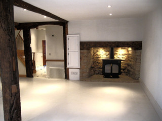 A feature fireplace lit from behind.